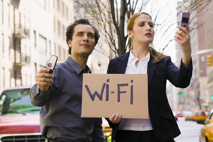 two-people-holding-sign-with-wifi-written-incognito-software