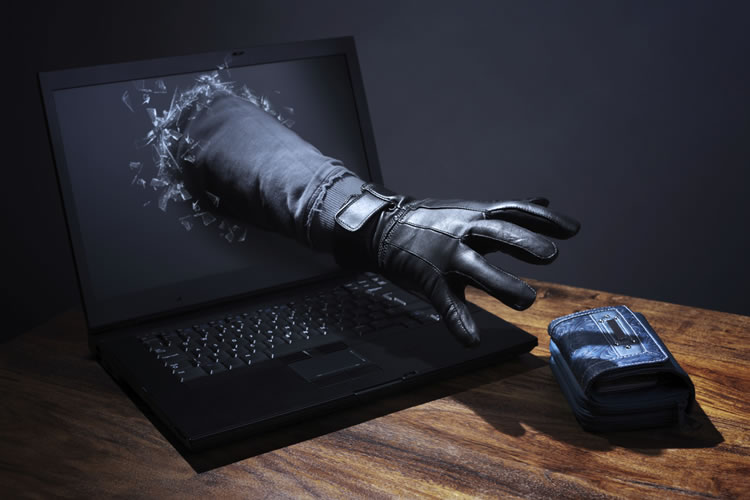 hand-with-black-globes-getting-outside-the-laptop-incognito-software