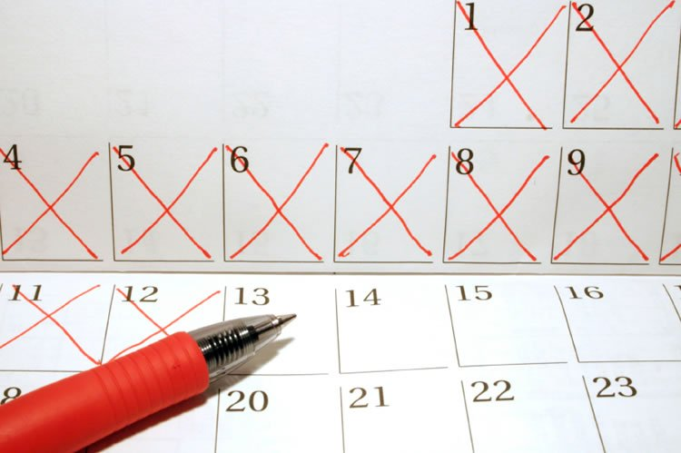calendar-with-days-that-passed-marked-and-a-pen-incognito-software
