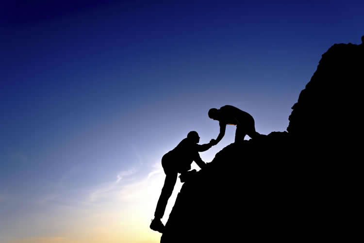 two-people-climbing-a-mountain-together-incognito-software