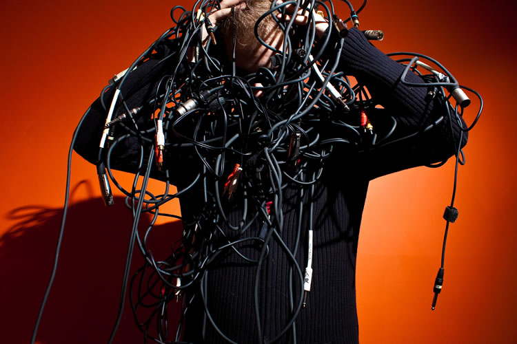 man-struggling-with-cables-incognito-software